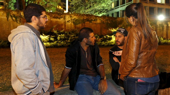 Former Guantanamo detainees Omar Mahmoud Faraj (L), Ali Shabaan (C) and Abdul din Muhammed Tawes (2nd R)  in front of the U.S. embassy in Montevideo