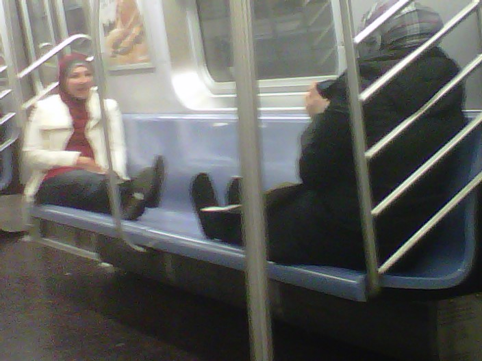 Here are few Muslim women spread out in the subway so nobody else can sit down