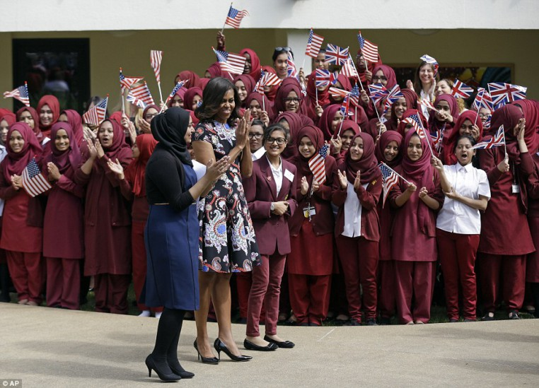 29A953D100000578-0-Greeting_Students_whooped_and_cheered_as_Mrs_Obama_made_her_way_-a-29_1434501795179-1