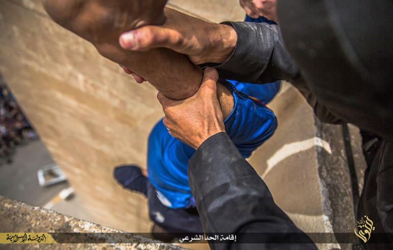 isis-executes-three-homosexuals-by-throwing-them-off-roof-graphic-pictures-14111