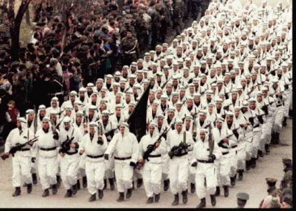 The Al-Qaeda-linked 'El-Mujahedeen' brigade of the Bosnian Muslim Army parading in downtown Zenica in central Bosnia in 1995, carrying the black flag of Islamic jihad