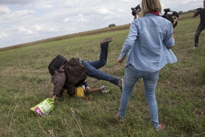 Hungarian camerawoman was fired after video came out showing her tripping several muslim illegals