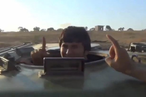 Flashing the ISIS one-finger salute