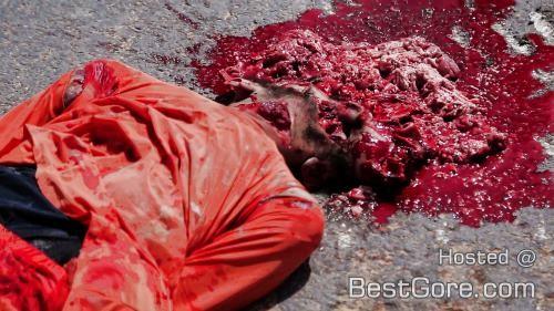 isis-ejecución-siria-hombre-correr-sobre-depósito-500x281
