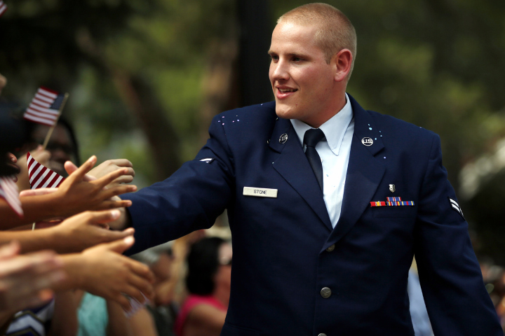 FILE - October 8: US Airman Spencer Stone, who stopped a terror attack on a train in France in August, has been stabbed several times, according to reports. SACRAMENTO, CA - SEPTEMBER 11: U.S. Air Force Airman First Class Spencer Stone shakes hands with the crowd during a parade honoring his August 21 actions in overpowering a gunman on a Paris-bound train on September 11, 2015 in Sacramento, California. Thousands lined the street along Capitol Mall to celebrate their hometown heroes. (Photo by Stephen Lam/ Getty Images)