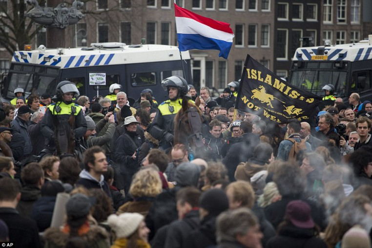 30EFED8300000578-3435093-Riot_police_were_also_needed_in_Amsterdam_today_in_order_to_sepa-a-13_1454797210124