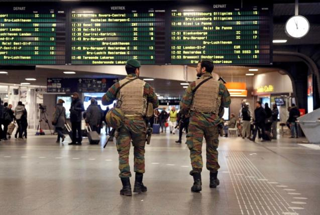 Belgian soldiers patrol in the arrival hall at Midi railway station in Brussels