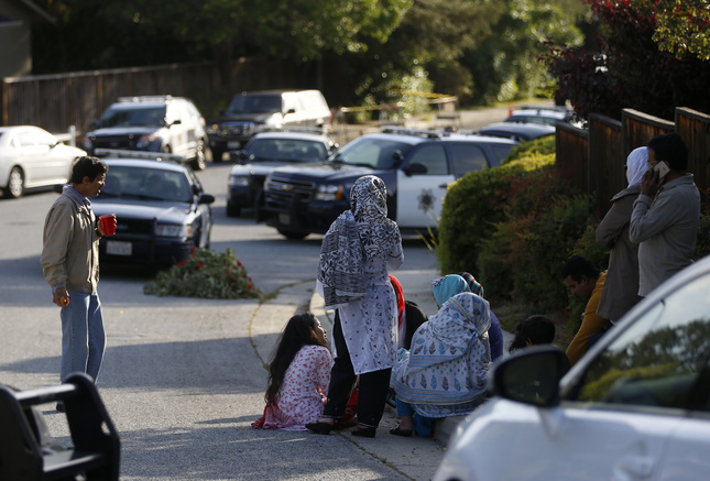 Family members wait on Lucas Dr. as San Jose police investigate a double homicide