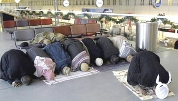 Muslims raising their asses to allah at airports scare other passengers