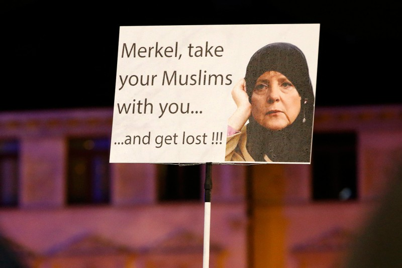 Sign seen at anti-Muslim migrant protest in Germany