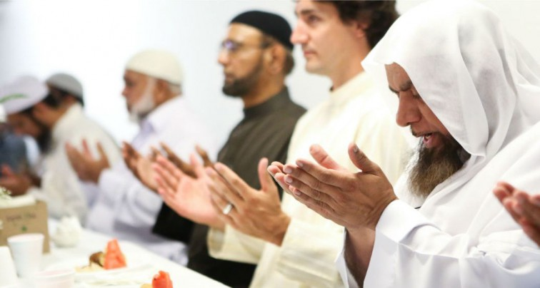 Justin Trudeau praying at a mosque