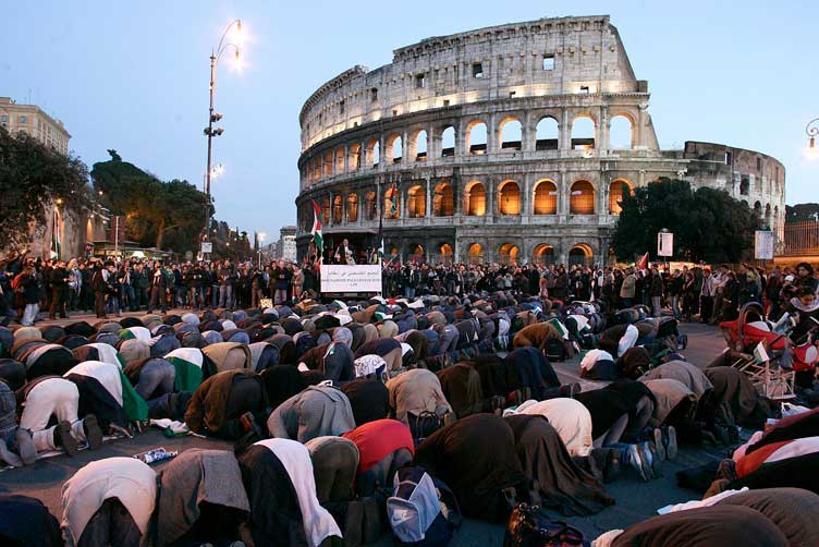 Muslims lifting their asses to Allah in front of landmarks like the Coliseum in Rome