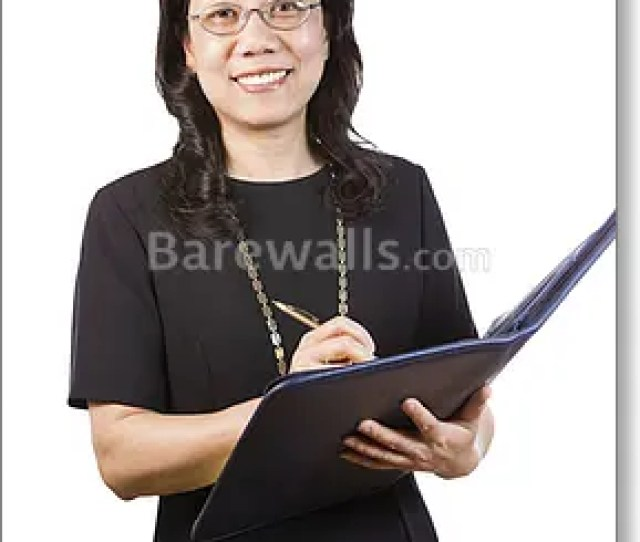 Mature Asian Woman In Business Attire With Writing Tools Art Print
