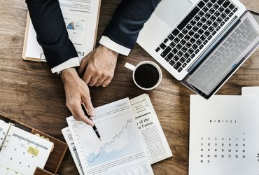 business plan writer pointing to increased sales