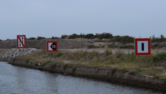 (L to R) No passing or overtaking, the channel is 10 metres from the bank, keep a sharp lookout