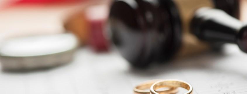 Gavel and wedding rings