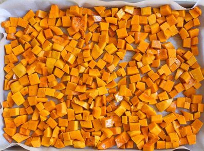 butternut squash on a pan before being roasted