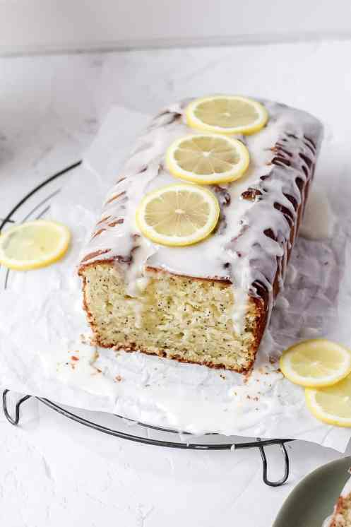 lemon poppy seed cake topped with sliced lemons