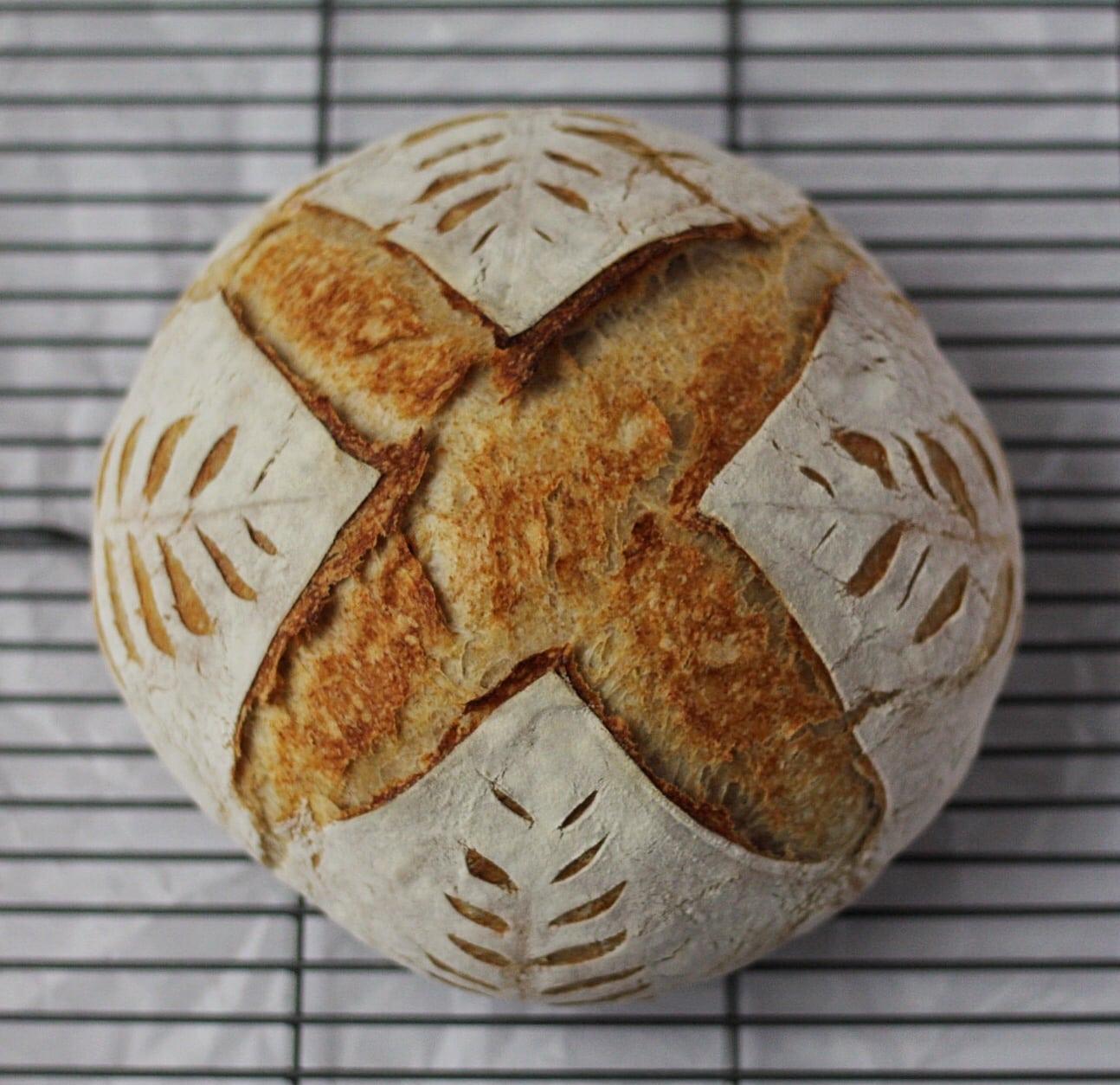 sourdough bread with intricate scoring design