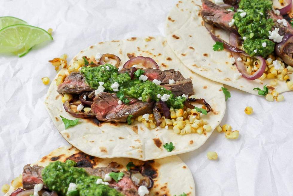 chimichurri steak tacos with grilled onions and corn