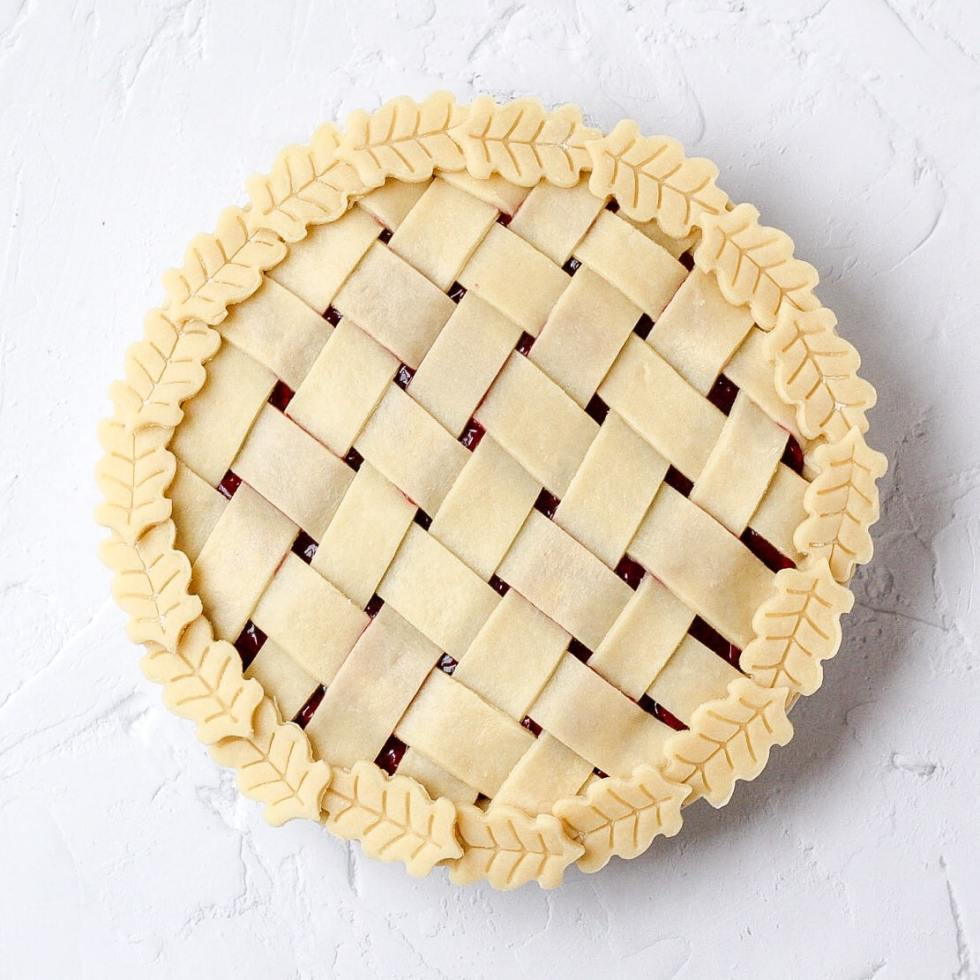 uncooked pie crust with lattice and leaves