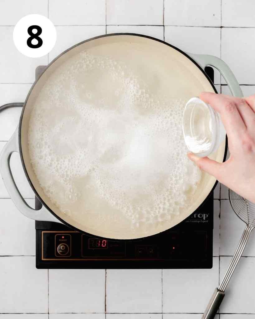 adding baking soda to water