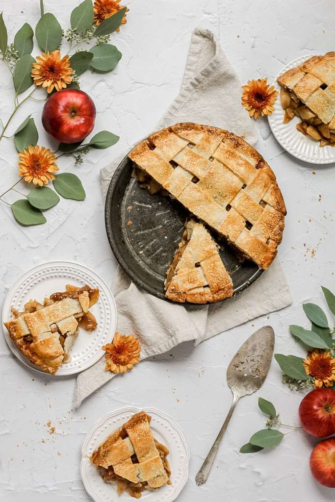 The best ever apple pie with lattice crust with slices cut out