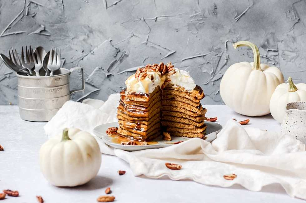 sourdough pumpkin pancakes with whipped cream, pecans, and honey