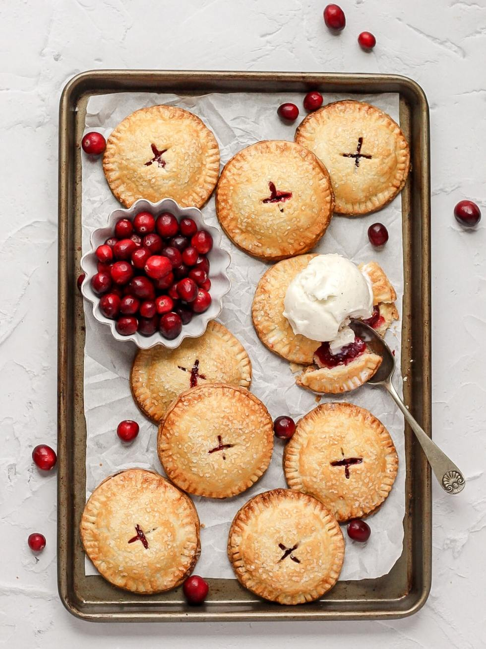 cranberry hand pies with fresh cranberries and scoop of vanilla ice cream