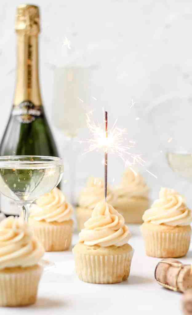 champagne cupcakes with glass and bottle of champagne