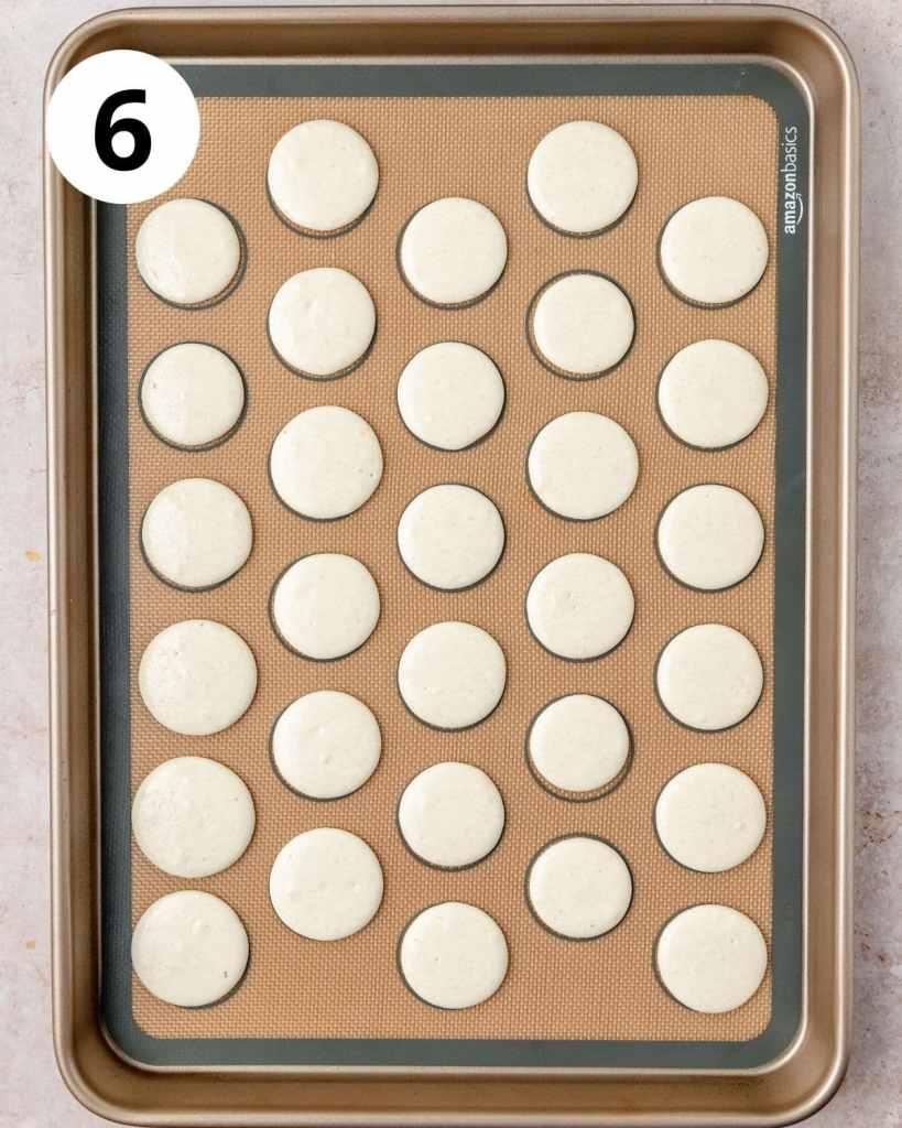 macarons resting on baking sheet before baking