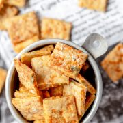 cheesy sourdough crackers in small bowl