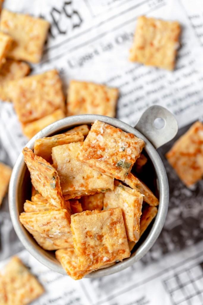 bowl full of sourdough crackers on newspaper