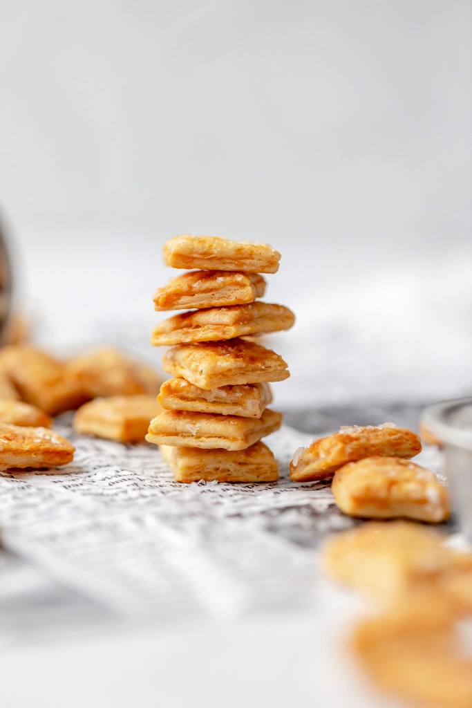 cheesy sourdough crackers in a stack