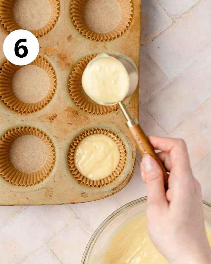 pouring cupcake batter into cupcake pan
