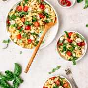 caprese pasta salad in 3 bowls
