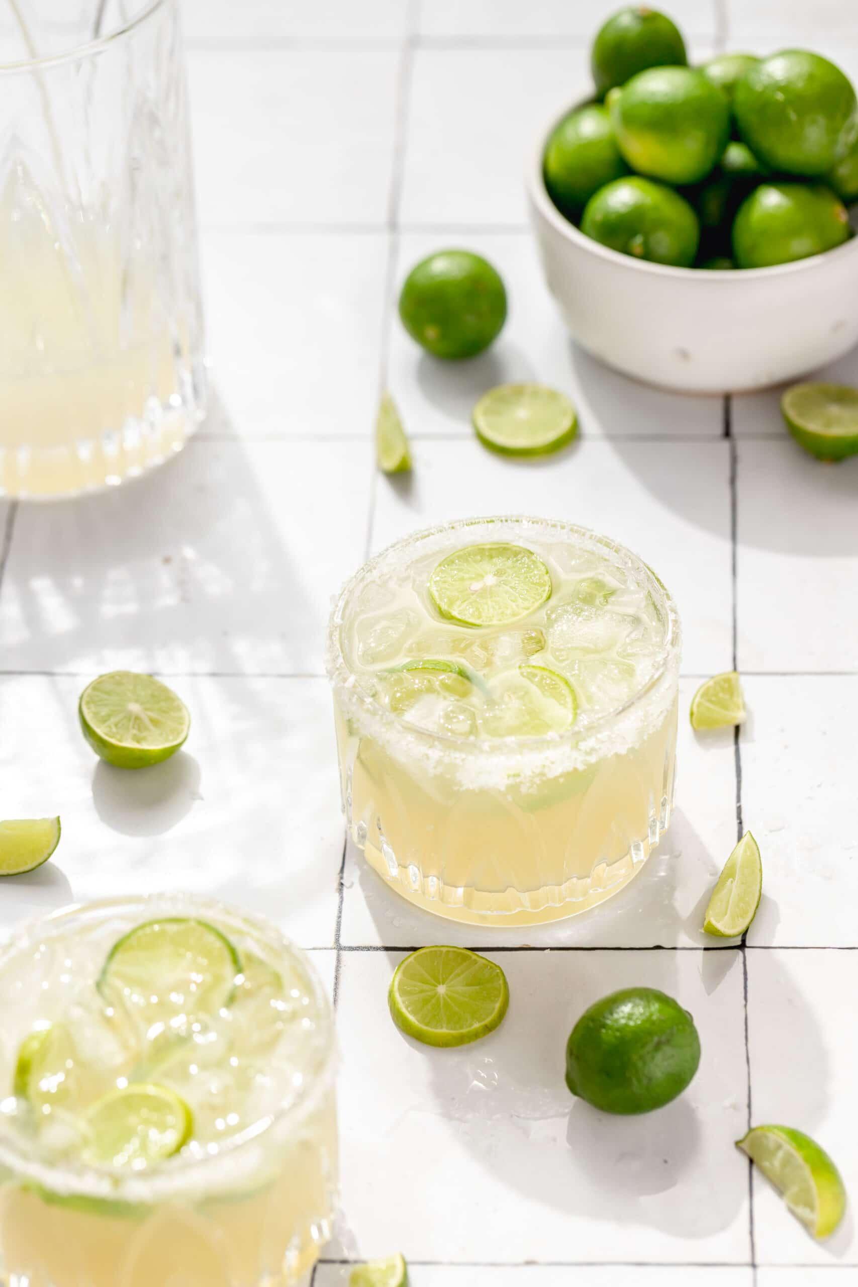 key lime margaritas with sliced key limes