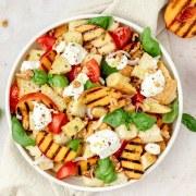 close up shot of grilled peach panzanella salad