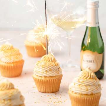 close up shot of champagne cupcakes with sparkler on top