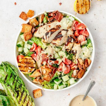 grilled chicken Caesar salad with grilled romaine lettuce