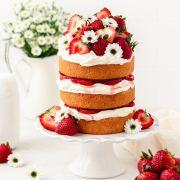 strawberry shortcake layer cake with fresh strawberries and whipped mascarpone