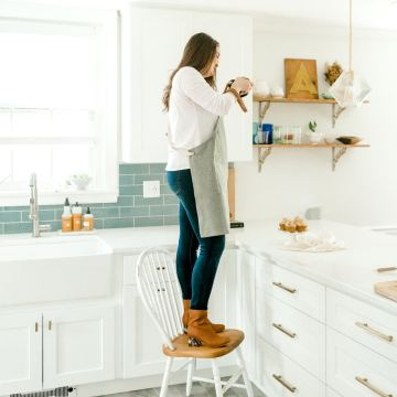 kyleigh standing on chair taking food photos