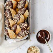 close up shot of dark chocolate hazelnut madeleines