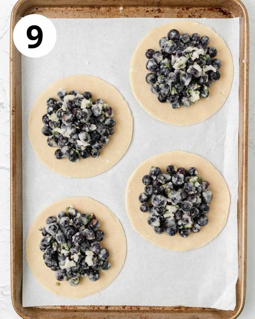 blueberry galette filling on pie dough circles