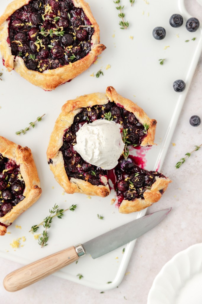 mini blueberry galettes with ice cream on top