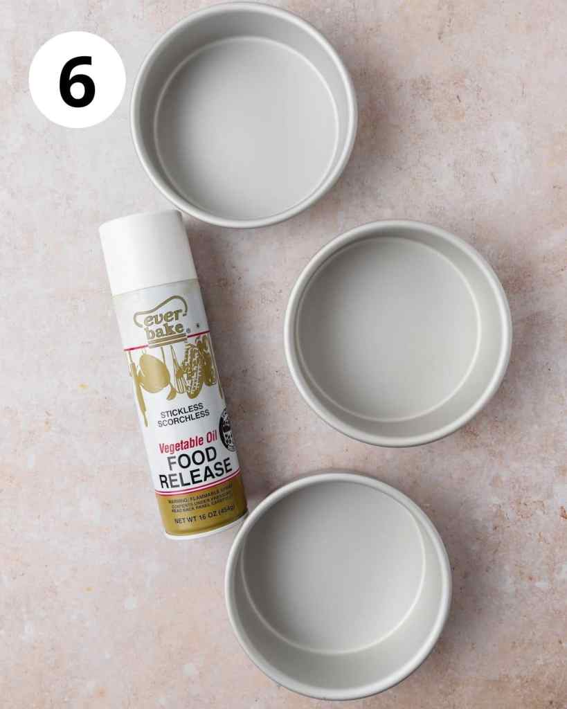 3 cake pans with bottle of pan spray