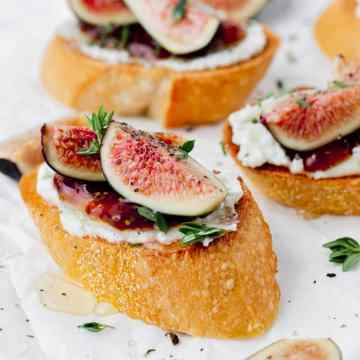 close up shot of fig and goat cheese crostini