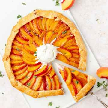 close up shot of peach and thyme galette