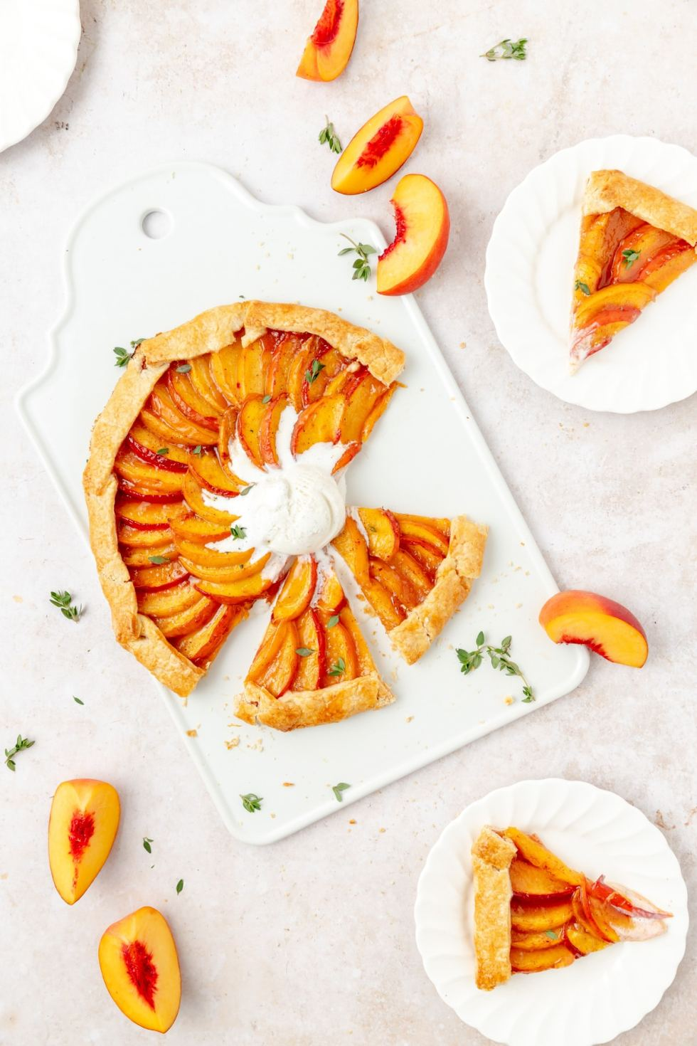 peach thyme galette with vanilla ice cream, cut into slices