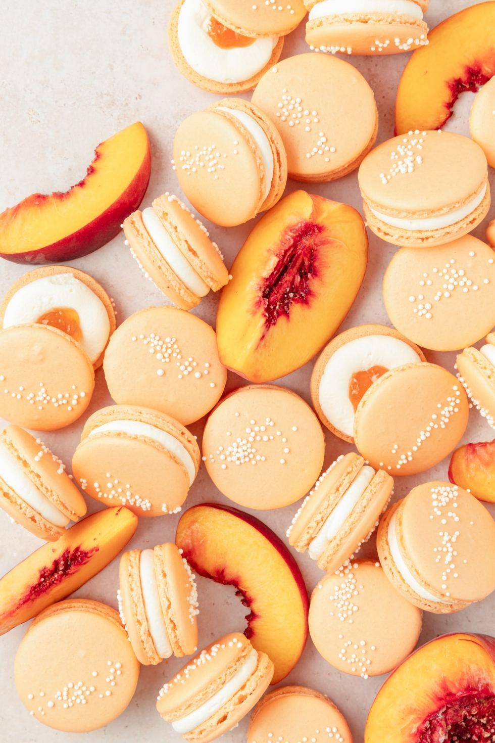 peach macarons with fresh peaches and whipped cream